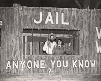 """Students in a mock """"jail cell"""" at the University of Houston's Frontier Fiesta (1950s).jpg"""