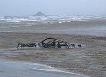 A Car Sunk In Stream On The Ninety Mile Beach
