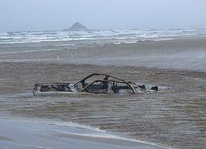 Ninety Mile Beach, New Zealand - A car sunk in a stream on the Ninety Mile Beach