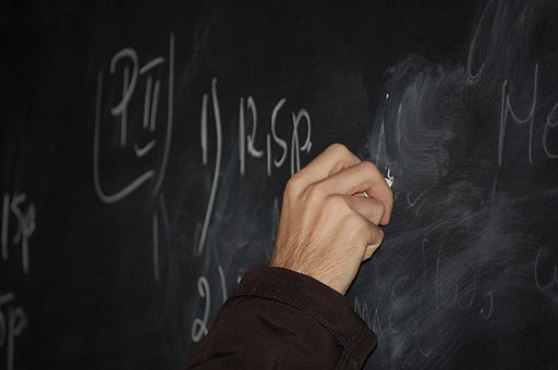 Teacher-writing-on-blackboard564