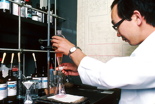 chemistry lab technician performing drug synthesis