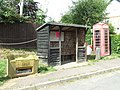 Telephone kiosk and bus shelter at Belchamp Walter, Essex.jpg