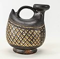 Terracotta askos (flask with spout and handle over top) MET sftr3832015.jpg