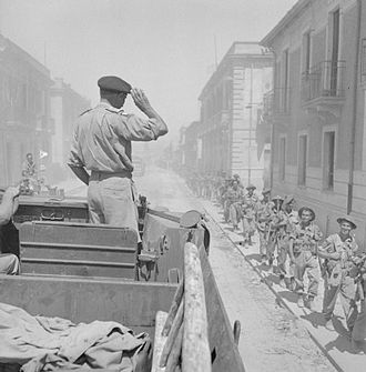 Allied invasion of Italy - General Montgomery salutes his troops from a DUKW, Reggio, Italy, September 1943.