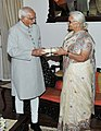 The Governor of Goa, Smt. Mridula Sinha presenting a book to the Vice President, Shri Mohd. Hamid Ansari, in Goa on September 22, 2014.jpg