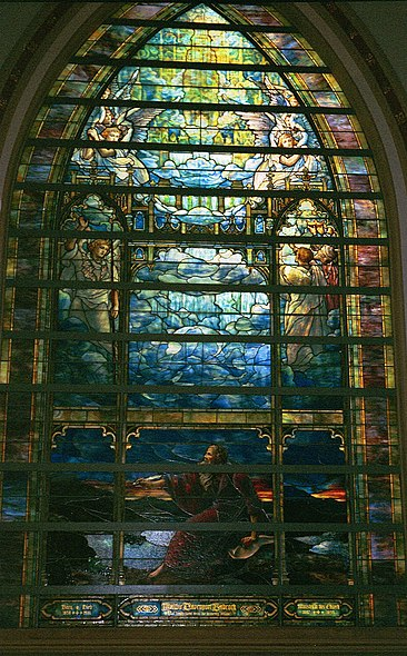 The Holy City (1905) - St. John's vision on the isle of Patmos, one of eleven Tiffany windows at Brown Memorial Presbyterian Church in Baltimore, Maryland. It has 58 panels and is thought to be one of the largest Tiffany Studios windows The Holy City.jpg