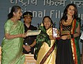 """The President, Smt. Pratibha Devisingh Patil presenting the Award for Best Supporting Actress to Ms. Kangana Ranaut for Hindi film """"Fashion"""", at the 56th National Film Awards function, in New Delhi on March 19, 2010.jpg"""