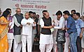 The Union Home Minister, Shri Rajnath Singh distributing the walking stick, at the distribution camp of the aids and assistive devices to the Divyang, at Lucknow.jpg