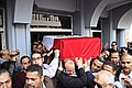 The body of slain Police Brigadier General Tariq al-Mirjawi is carried out of the Agouza Police Hospital after a series of explosions hit Cairo University - Cairo 2-Apr-2012.jpg