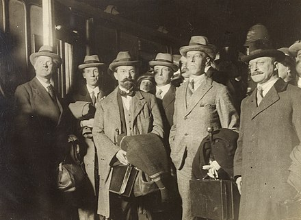 Members of the Irish negotiation committee returning to Ireland in December 1921 The peacemakers- George Gavan Duffy, Erskine Childers, Robert Barton and Arthur Griffith in a group (28455606301).jpg