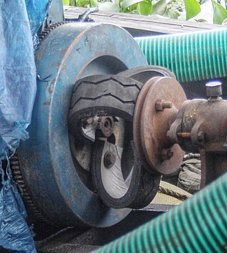Coupling - An improvised flexible coupling made of car tire pieces connects the drive shafts of an engine and a water pump. This one is used to cancel out misalignment and vibrations.