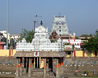 image of a temple tower with a tank and a pillared hall in its centre