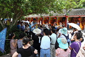 Tour guide addressing a group in China.JPG