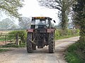 Tractor on the road from Shredicote Farm - geograph.org.uk - 400942.jpg