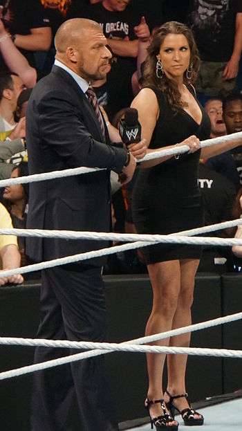 Current WWE minority owners/front office executives/wrestlers Triple H and his wife Stephanie McMahon Triple H and Stephanie McMahon 2014.jpg
