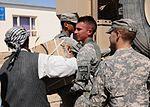 Troops Drop Off Needed School Supplies DVIDS323588.jpg