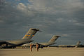 U.S. Air Force Master Sgt. Bill Lasage and Airman First Class Jamil Harrison, both C-17A Globemaster III aircraft loadmasters assigned to the 14th Airlift Squadron, walk to their aircraft to prepare it for 100822-F-RR679-135.jpg