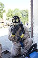 U.S. Army Sgt. Claude Williams, with the 73rd Civil Support Team, Kansas Army National Guard, removes his protective mask after getting clear of simulated radiation during a Vibrant Response 13 exercise 120807-A-PX072-041.jpg