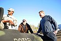 U.S. Army Sgt. Jon Jairston, left, with the 1257th Transportation Company, West Virginia Army National Guard, and community members Bob Setter, center, and Charley Richard work together to draw from the water 140112-Z-MJ412-625.jpg