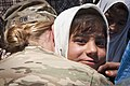 U.S. Army Spc. Helen Jeschow, left, an information support operations specialist with the 340th Tactical Military Information Support Operations Company, Task Force Tsunami, hugs an Afghan girl she befriended 120603-A-ZU930-001.jpg