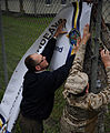 U.S. Marine Corps Staff Sgt. Thomas Rice and Abraham Gunn, both with Headquarters European Command, prepare the site for exercise Combined Endeavor 2010 Aug. 29, 2010, in Grafenwoehr, Germany 100829-F-UA515-033.jpg