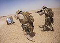 U.S. Marines with the 26th Marine Expeditionary Unit's maritime raid force fire an M4 carbine and an M1911 .45-caliber pistol at a range in Jordan June 9, 2013, during exercise Eager Lion 2013 130609-M-SO289-022.jpg