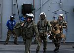 U.S. Navy air traffic controllers, assigned to Tactical Air Control Squadron (TACRON) 21 aboard the amphibious assault ship USS Nassau (LHA 4), follow an aviation crewman to board an MH-60S Seahawk helicopter 080919-N-OW936-271.jpg
