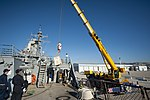 U.S. Sailors prepare to receive equipment being craned aboard the guided missile destroyer USS Arleigh Burke (DDG 51) March 8, 2014, in Marseille, France 140308-N-WD757-067.jpg