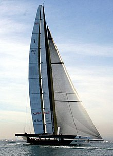 Color photograph of a racing catamaran underway with the starboard hull out of the water