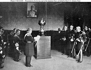 """Thomas J. O'Brien (Michigan politician) - While serving as U.S. Ambassador to Japan, O'Brien (right center) looks on as Rear Admiral John Hubbard (right foreground) presents a loving cup to the Imperial Japanese Navy on behalf of the U.S. Atlantic Fleet in Tokyo, Japan, in January 1910 in recognition of the courtesy extended to the """"Great White Fleet"""" during its October 1908 visit to Japan. Admiral Saitō Makoto (left foreground) accepts it; Admiral Heihachiro Togo is just beyond and to left of Saitō."""
