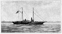 """Black and white image of USS Hetzel from a watercolor painting. She lies at anchor, her clipper bow to the right. She carries two masts; a large American flag flies from the gaff of the after (main) mast. The starboard sidewheel is a little aft of directly midship. The single stack is about equally far forward. Superstructure includes a pilot house forward of the stack, some parts of the engines, and a row of cabins aft of the stack. One gun is mounted on the main deck forward, and another is at the stern."""