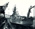 USS Newport News (CA-148) in drydock at the Norfolk Navy Yard 1965.jpg