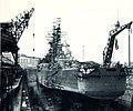 USS Newport News (CA-148) in drydock at the Norfolk Navy Yard 1965.jpg