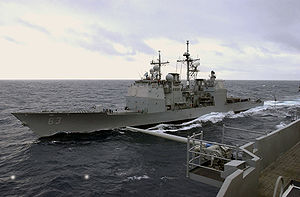 US Navy 031015-N-5821P-001 USS Cowpens (CG 63) pulls alongside USS Kitty Hawk (CV 63) for replenishment-at-sea evolutions.jpg