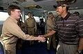 US Navy 040303-N-5319A-001 Tiger Woods meets Commander Carrier Group Eight (CCG-8) Rear Adm. Denby H. Starling II, on the flag bridge aboard the aircraft carrier USS George Washington (CVN 73).jpg