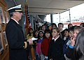 US Navy 040312-N-8955H-014 Lt. Tom Cotton, of Gainesville, Fla., explains the USS Blue Ridge (LCC 19) chain of command to a Nagoya International School's 4th grade class while giving a tour of the ship.jpg