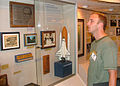 US Navy 040703-N-3520M-005 Actor Jay Mohr takes a moment to look at the museum aboard nuclear powered USS John C. Stennis (CVN 74).jpg