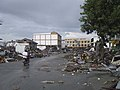 US Navy 050101-O-XXXXB-072 Trash and debris line the streets while locals check on the aftermath in down town Aceh, Sumatra following a massive Tsunami that struck the area on the 26th of December 2004.jpg