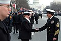 US Navy 050120-N-0962S-060 Master Chief Petty Officer of the Navy (MCPON) Terry Scott shakes hands with one of the hundreds of Sailors who helped line the street cordon down Pennsylvania Avenue for the Inauguration Day Parade.jpg