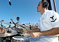 US Navy 050122-N-3019M-012 Musician 3rd Class Ross Hartig performs at the 2005 Hula Bowl All-Star game in Kahului, Maui. Eight members of the Pacific Fleet Rock Band represented the Navy at the game.jpg