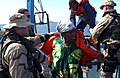US Navy 050430-N-5526M-041 Sailors aid men and women after their boat, a fishing vessel, capsized 25 miles off the coast of Somalia.jpg