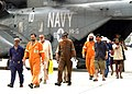 US Navy 050512-N-9563N-003 Motor Vessel Olympias crew members arrive at the aviation unit of Naval Support Activity, Bahrain, after being rescued at sea by Sailors assigned to the guided missile destroyer USS Mustin (DDG 89).jpg