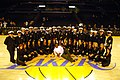 US Navy 061210-N-6536T-107 Crew members from the fast attack submarine USS Los Angeles (SSN 688) pose for a photo with the Los Angeles Lakers Cheerleaders and former NBA player and Annapolis Naval Academy graduate David Robinso.jpg