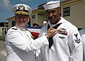 US Navy 061215-N-9167V-032 Rear Adm. Donald Bullard, Commander, Navy Expeditionary Combat Command (NECC), displays the Expeditionary Warfare pin, the Navy's new warfare device, given to Master-at-Arms 2nd Class Carl Hurtt.jpg