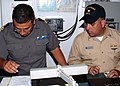 US Navy 070326-N-4716P-033 Lt. Jorge Castaon, Mexican navy operations officer and Lt. Cdr. Carlos Muoz, assistant operations officer aboard USS Tarawa (LHA 1) review leap frog maneuver procedures.jpg