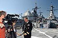 US Navy 070524-N-5459S-027 Commander, Standing NATO Maritime Group One (SNMG1), Rear Adm. Michael K. Mahon speaks to the local media on the flight deck of the guided-missile destroyer USS Mahan (DDG 72).jpg