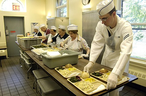 US Navy 070524-N-8467N-002 Seaman Apprentice Christopher Clement prepares trays at Holy Apostles Soup Kitchen in Manhattan