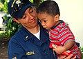 US Navy 070531-N-0120A-110 Ensign Jennifer A. Sanders assigned to dock landing ship USS Harpers Ferry (LSD 49), holds a Filipino child.jpg