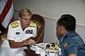 US Navy 080721-N-8138M-012 Rear Adm. Nora W. Tyson, commander, Logistics Group Western Pacific, speaks with Commodore Slamet Yulistiyono.jpg