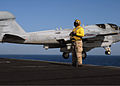 US Navy 081103-N-9900B-007 Chief Aviation Boatswain's Mate (Handling) Richard McCray stands by as an EA-6B Prowler assigned to the.jpg